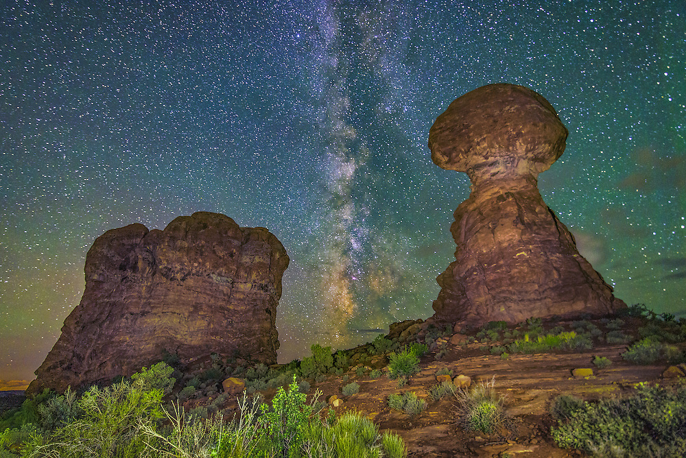 The Milky Way setting in between the Balanced Rock in Arches National Park in Moab, Utah.