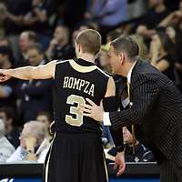 Central Florida head coach Donnie Jones talks with Central Florida guard A.J. Rompza (3) during the NCAA basketball game against the USF Bulls at the UCF Arena on November 18, 2010 in Orlando, Florida. UCF won the game 65-59. (AP Photo/Alex Menendez)