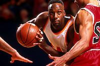 Men playing basketball, close-up of man holding ball