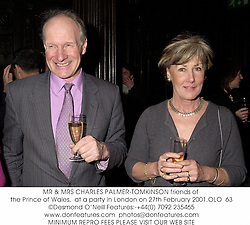 MR & MRS CHARLES PALMER-TOMKINSON friends of the Prince of Wales,  at a party in London on 27th February 2001.	OLO  63