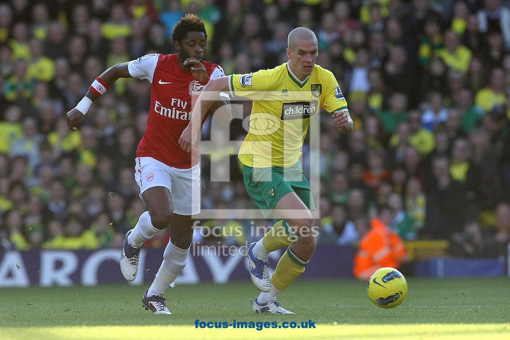 Picture by Paul Chesterton/Focus Images Ltd.  07904 640267.19/11/11.Steve Morison of Norwich beats Arsenal's Alex Song during the Barclays Premier League match at Carrow Road stadium, Norwich.