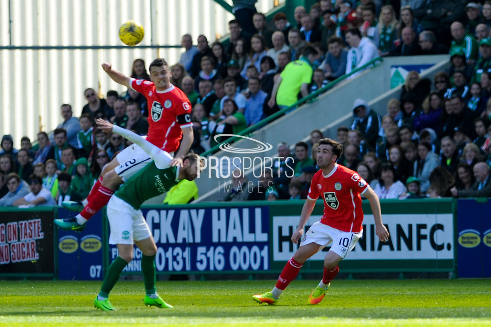 Stephen McGinn wins ball over Andrew Shinnie during the Ladbrokes Scottish Championship match between Hibernian and St Mirren at Easter Road, Edinburgh, Scotland on 6 May 2017. Photo by Kevin Murray.