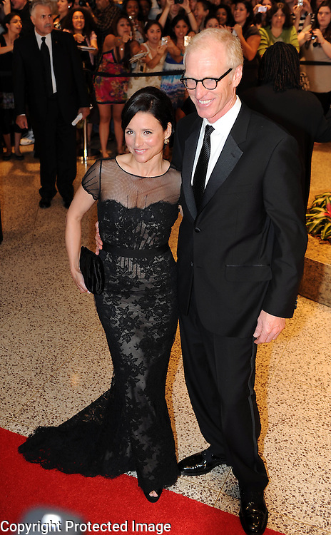 Julia Louis Dreyfus and Brad Hall arrive for the White House Correspondents Dinner in Washington, DC