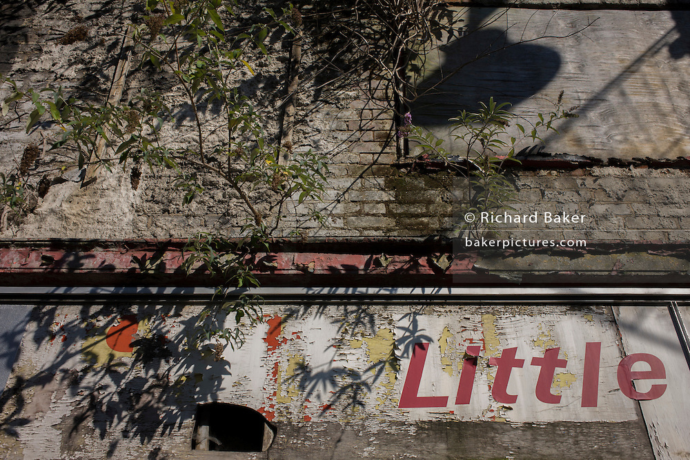 The word Little on a former shop's feeling frontage.
