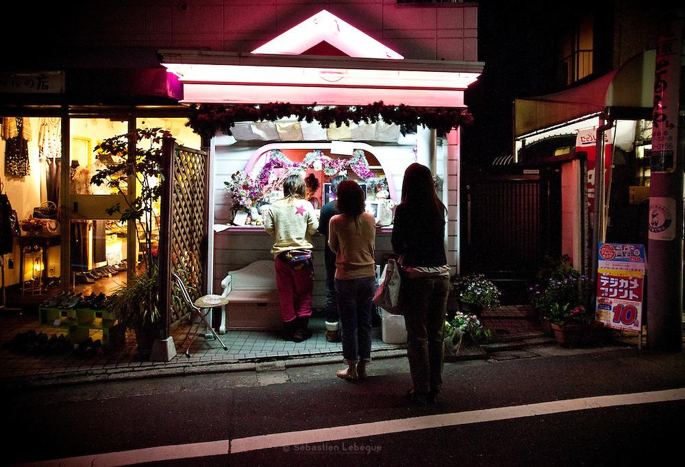 TOKYO, JAPAN, 28 APRIL - ShimoKitaZawa- Girls make the line outiside of pink shop - APRIL 2012