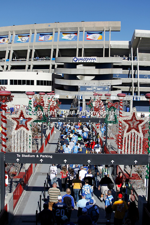 Christmas decorations line the walkway as San Diego Chargers fans leave the train station and walk toward Qualcomm Stadium for the Chargers NFL week 14 football game against the Kansas City Chiefs on Sunday, December 12, 2010 in San Diego, California. The Chargers won the game 31-0. (©Paul Anthony Spinelli)