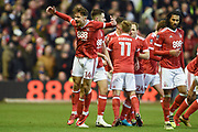 Nottingham Forest midfielder Matty Cash (14) celebrates after Forest score a goal to make it 1-0 during the The FA Cup 3rd round match between Nottingham Forest and Arsenal at the City Ground, Nottingham, England on 7 January 2018. Photo by Jon Hobley.