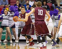 Woodrow Wilson forward Brent Osborne (44) looks to pass to Woodrow Wilson guard Corey Acord (10) during a semi-final game at the Charleston Civic Center.