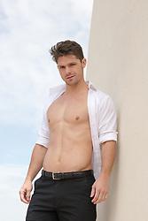 hot man with an open shirt outdoors