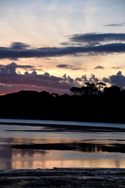 Raglan Beach as the sunset starts to turn pink