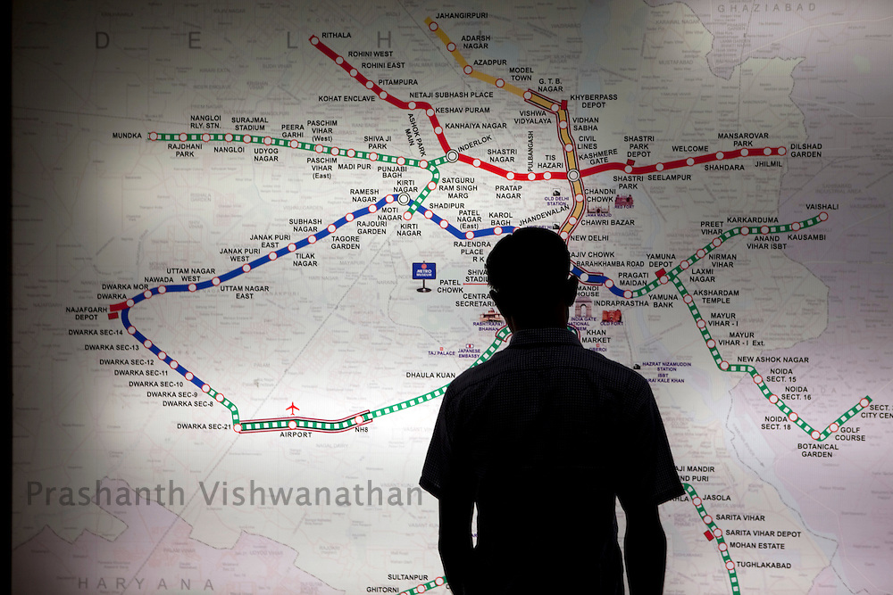 A passenger looks at the rail map of the Delhi Metro network at the Central Secratariat station in New Delhi, India, on Friday, October 22, 2010. Photographer: Prashanth Vishwanathan/HELSINGIN SANOMAT