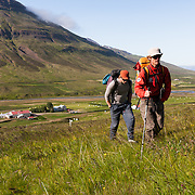 Jökull Bergmann and Freyr Ingi Björnsson at the start of the two hour walk up to the climb, Kerlingareldur 5.9 200m. The walk begins at the farm house, Melar, Svarfaðardal.