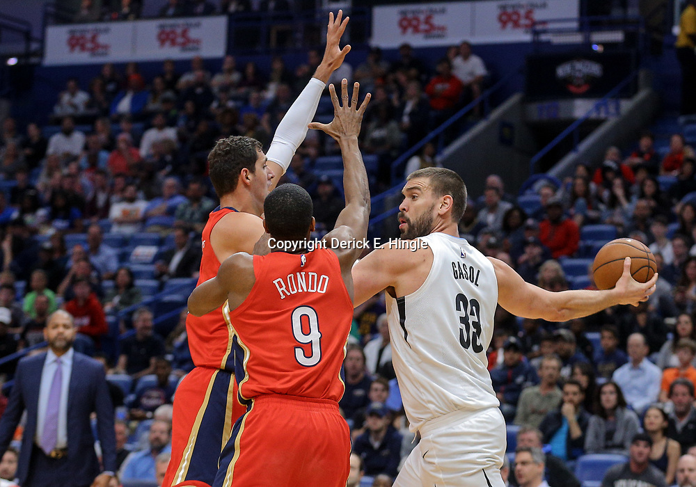 Apr 4, 2018; New Orleans, LA, USA; Memphis Grizzlies center Marc Gasol (33) is defended by New Orleans Pelicans forward Nikola Mirotic and guard Rajon Rondo (9) during the first quarter at the Smoothie King Center. Mandatory Credit: Derick E. Hingle-USA TODAY Sports