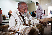 An elderly man, blind in one eye, and displaced by flooding seeks shelter and food at the Workers Welfare School on the outskirts of  Muzzafargarh. ..The school currently accommodates 2,271 people, including 999 children who have fled devastating floods in the neighbouring villages...Residents of outlying villages in the district of Muzzafargarh continue to evacuate villages as flood waters continue to cause havoc in South Punjab...