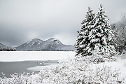 Fresh snow covers everything in this white on white view of the Bubbles across Jordan Pond in Acadia National Park.