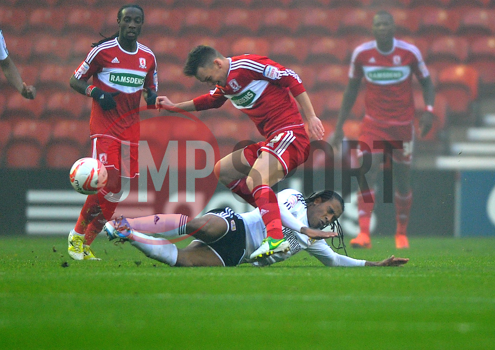 Bristol City's Neil Danns tackles Middlesbrough's Josh McEachran - Photo mandatory by-line: Joe Meredith/JMP  - Tel: Mobile:07966 386802 24/11/2012 - Middlesbrough v Bristol City - SPORT - FOOTBALL - Championship -  Middlesbrough  - River Side Stadium