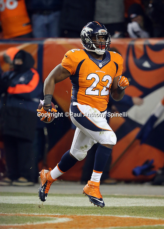 Denver Broncos running back C.J. Anderson (22) runs through the end zone in celebration after running for a 39 yard touchdown good for a 17-14 Broncos lead during the 2015 NFL week 16 regular season football game against the Cincinnati Bengals on Monday, Dec. 28, 2015 in Denver. The Broncos won the game in overtime 20-17. (©Paul Anthony Spinelli)