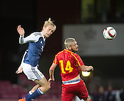 Scotland's Oliver McBurnie oujumps FYR Macedonia's Darko Velkoski during Scotland Under-21 v FYR Macedonia,  UEFA Under 21 championship qualifier  at Tynecastle, Edinburgh. Photo: David Young<br /> <br />  - © David Young - www.davidyoungphoto.co.uk - email: davidyoungphoto@gmail.com