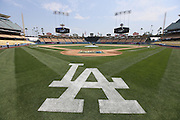 LOS ANGELES, CA - JUNE 30:  Groundskeepers prepare the field in this general view of the stadium before the Los Angeles Dodgers game against the Philadelphia Phillies on Sunday, June 30, 2013 at Dodger Stadium in Los Angeles, California. The Dodgers won the game 6-1. (Photo by Paul Spinelli/MLB Photos via Getty Images)