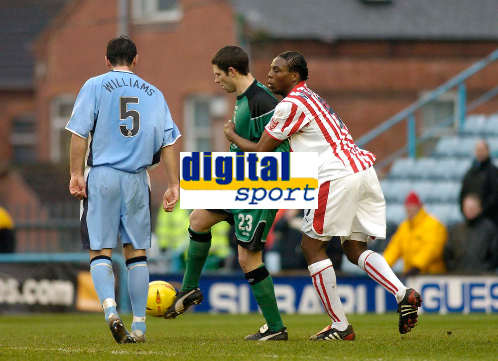 Photo. Glyn Thomas. 22/02/2005.<br /> Coventry City v Stoke City. Coca Cola Championship.<br /> Coventry's keeper Ian Bennett (C) tussles with Stoke's Gifton Noel-Williams (R) after Bennett was deemed to have handled the ball outside the penalty area. He was then shown the red card.
