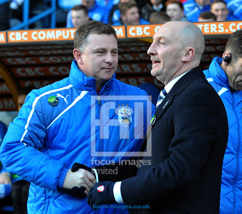 Picture by Graham Crowther/Focus Images Ltd +44 7763 140036<br /> 11/01/2014<br /> Mark Robins manager of Huddersfield Town and Ian Ho;;oway manager of Millwall during the Sky Bet Championship match at the John Smiths Stadium, Huddersfield.