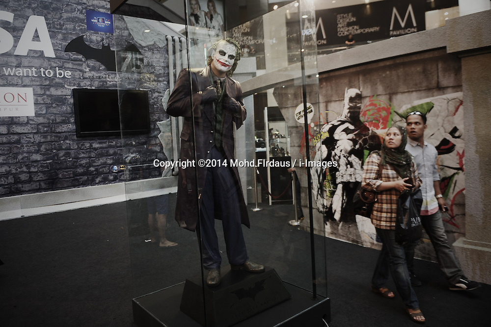 Visitors walk as they look at Joker figure during the exhibition in conjunction with Batman's 75th anniversary in a shopping mall in Kuala Lumpur on Jun 02, 2014. The Batman 75th Anniversary celebration Malaysia is from 28 May 2014 & will run till 15 June 2014, Monday, 2nd June 2014. Picture by Mohd FIrdaus / i-Images