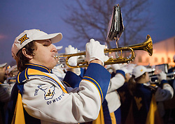 WVU band members perform during a pep rally in downtown Memphis Sunday night.