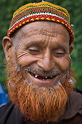 Bearded, toothless man smiling in Kashmir, India