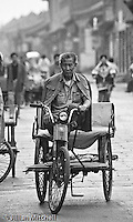 On the streets of Pingyao, China back in 2001.<br /> <br /> Images in this gallery were taken using film and are presented in small, low resolution files - high resolution scans or the original slide/negative are also available.