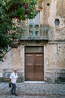 """ACCIAROLI, ITALY - 14 SEPTEMBER 2018: A woman walks by the Hotel La Scogliera, where Ernest Hemingway stayed in 1951, in Acciaroli, a small fishing village  in the municipality of Pollica, Italy, on September 14th 2018. During his stay in Acciaroli, Ernest Hermingway drew inspiration for his masterpiece """"The Old Man and the Sea"""".<br /> <br /> To understand how people can live longer throughout the world, researchers at University of California, San Diego School of Medicine have teamed up with colleagues at University of Rome La Sapienza to study a group of 300 citizens, all over 100 years old, living in Acciaroli (Pollica), a remote Italian village nestled between the ocean and mountains in Cilento, southern Italy.<br /> <br /> About 1-in-60 of the area's inhabitants are older than 90, according to the researchers. Such a concentration rivals that of other so-called blue zones, like Sardinia and Okinawa, which have unusually large percentages of very old people. In the 2010 census, about 1-in-163 Americans were 90 or older."""