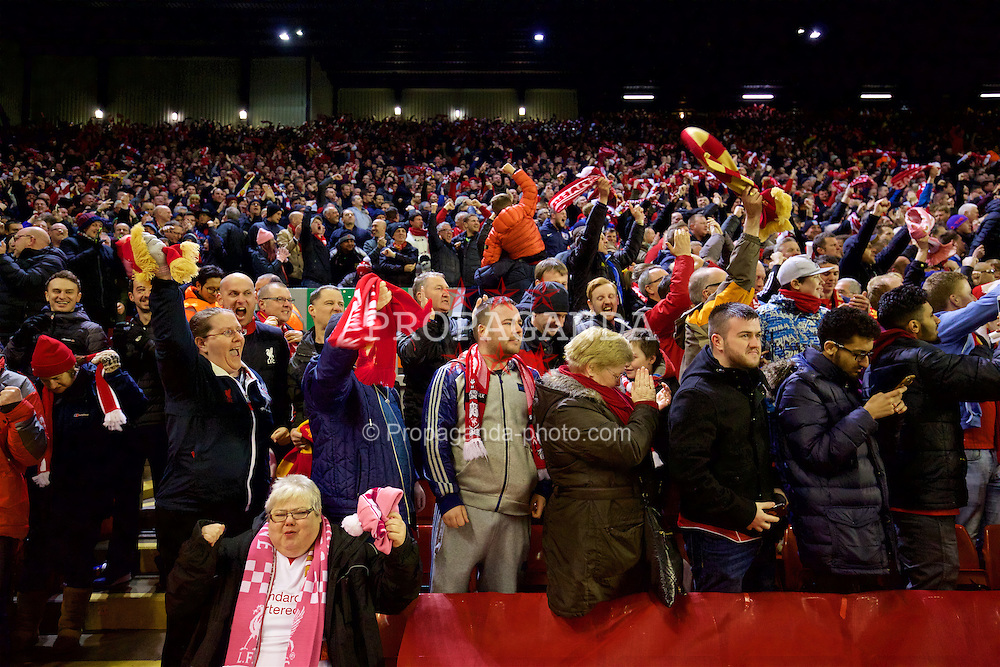 LIVERPOOL, ENGLAND - Thursday, March 10, 2016: Liverpool supporters celebrate the second goal against Manchester United during the UEFA Europa League Round of 16 1st Leg match at Anfield. (Pic by David Rawcliffe/Propaganda)