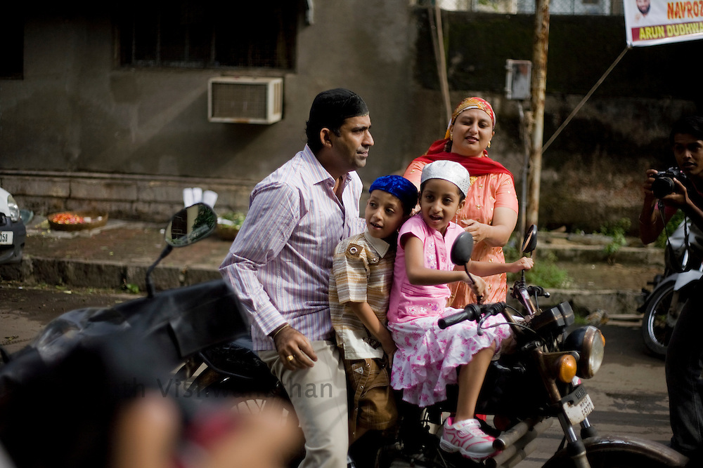 A Parsi family arrives at the Kappawala Agiary, or Fire Temple, on Navroze, the Parsi new year, in Mumbai, India, Tuesday, Aug. 19, 2008. Parsis, also known as Zoroastrians, worship fire and are followers of the Bronze Age Persian prophet Zarathustra. According to estimates there are only 150,000 Zoroastrians in the world today and more than 80,000 live in India, mostly in Mumbai. Photographer:Prashanth Vishwanathan/Atlas Press