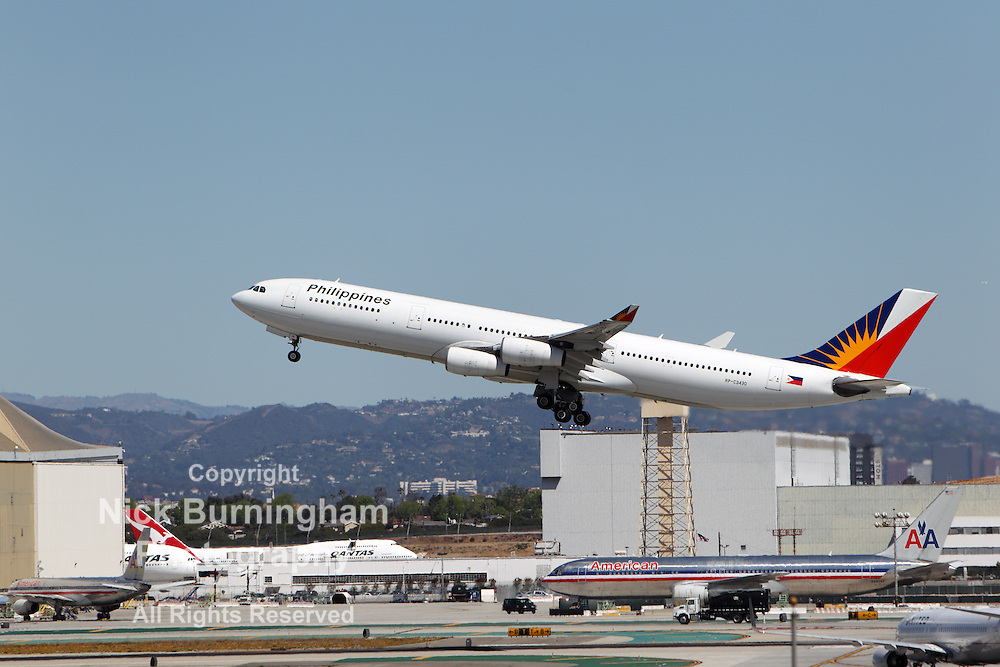LOS ANGELES, CALIFORNIA, USA - April 17, 2013 - Philippine Airlines<br /> Airbus A340-313X takes off from Los Angeles Airport on April 17, 2013. The plane has a range of 13,700 km and seats up to 335 passengers.