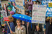 An ti brexit protestors join the march - NHS In Crisis - Fix It Now March and Demonstration - organised by the Peoples Assembly started in Gower Street and finished outside Downing street.