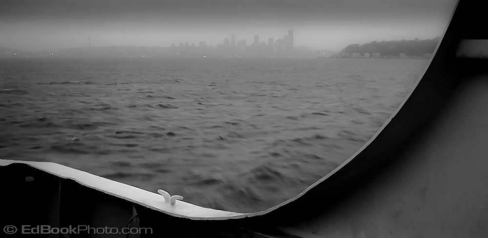an early rainy gloomy morning trip on a ferry to Seattle across Puget Sound, Washington, USA