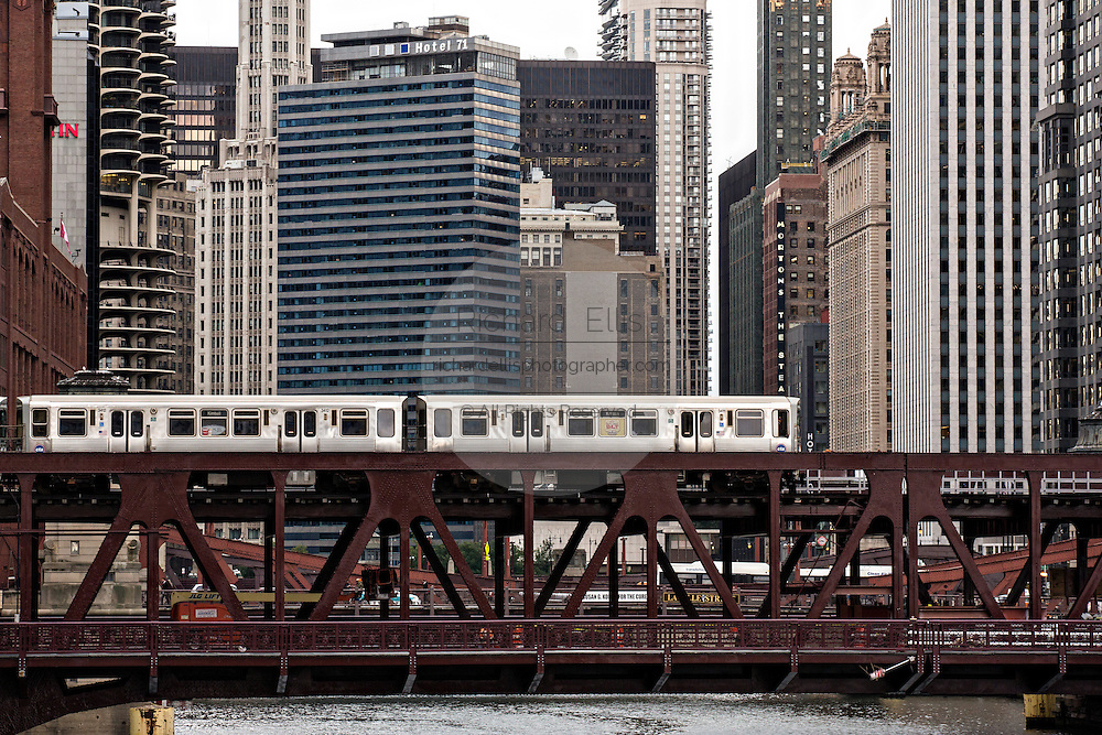 Elevated train known as the L crossing the Chicago River on the North Wells Street bridge in Chicago, IL.