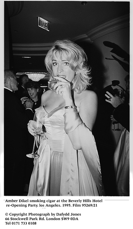 Amber Dikel smoking cigar at the Beverly Hills Hotel <br />
