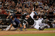 Sep 8, 2017; Phoenix, AZ, USA; San Diego Padres outfielder Manuel Margot (7) is tagged out at by Arizona Diamondbacks catcher Chris Herrmann (10) in the third inning at Chase Field. Mandatory Credit: Jennifer Stewart-USA TODAY Sports