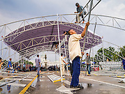 23 NOVEMBER 2012 - BANGKOK, THAILAND:  Members of the Pitak Siam anti-government group in Bangkok set up the stage for their protest in front of a statue of Thai King Rama V in Bangkok Friday. Thai authorities have imposed the Internal Security Act (ISA), that enables police to call on the army if needed to keep order, and placed thousands of riot police in the streets around Government House in anticipation of a large anti-government protest Saturday. The group sponsoring the protest, Pitak Siam, said up to 500,000 people could turn out to protest against the government. They are protesting against corruption in the current government and the government's unwillingness to arrest or pursue fugitive former Prime Minister Thaksin Shinawatra, deposed in 2006 coup and later convicted on corruption charges. The current Thai Prime Minister is Yingluck Shinawatra, Thaksin's sister.      PHOTO BY JACK KURTZ