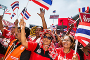 20 NOVEMBER 2013 - BANGKOK, THAILAND:  Red Shirt supporters rally in support of the government. Thousands of Red Shirts, supporters of the Pheu Thai ruling party in Thailand, gathered in Rajamangala Stadium in suburban Bangkok to listen to the Thai Constitutional Court deliver its verdict against the government. The court ruled that the recent efforts by the government to pass a blanket amnesty bill violated the Thai Constitution but the court did not order the party to disband or the dissolution of the government, which had been widely feared.     PHOTO BY JACK KURTZ
