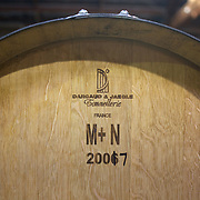 A Dargaud & Jaegle Tonnellerie Wine barrel from France  at the cellar door at Cloudy Bay Vineyard, Jackson Road, Marlborough, New Zealand..The winery and vineyards are situated in the Wairau Valley in Marlborough at the northern end of New Zealand's South Island. This unique and cool wine region enjoys a maritime climate with the longest hours of sunshine of any place in New Zealand. Wairau Valley, Marlborough, New Zealand. 9th February 2011. Photo Tim Clayton