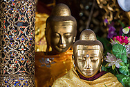 Close-up of two Buddha statues at the Shwedagon Pagoda in Yangon, Myanmar.