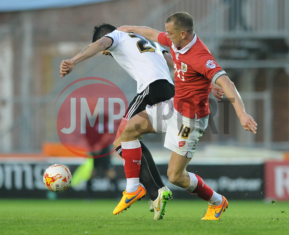 Bristol City's Aaron Wilbraham tackles Swindon Town's Raphael Rossi Branco - Photo mandatory by-line: Dougie Allward/JMP - Mobile: 07966 386802 - 07/04/2015 - SPORT - Football - Bristol - Ashton Gate - Bristol City v Swindon Town - Sky Bet League One