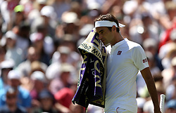 Roger Federer on day One of the Wimbledon Championships at the All England Lawn Tennis and Croquet Club, Wimbledon