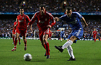 Photo: Paul Thomas.<br /> Chelsea v Liverpool. UEFA Champions League. Semi Final, 1st Leg. 25/04/2007.<br /> <br /> Andriy Shevchenko (R) of Chelsea shoots past Jamie Carragher.