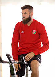 CARDIFF, WALES - Monday, September 3, 2018: Wales' Joe Ledley on a warm-up bike in the pre-activation tent before a training session at the Vale Resort ahead of the UEFA Nations League Group Stage League B Group 4 match between Wales and Republic of Ireland. (Pic by David Rawcliffe/Propaganda)