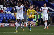 Coventry City's Carl Baker (c) get away from Tranmere Rovers' Stephen Arthurworrey.Skybet football league 1match, Tranmere Rovers v Coventry city at Prenton Park in Birkenhead, England on Saturday 22nd Feb 2014.<br /> pic by Chris Stading, Andrew Orchard sports photography.