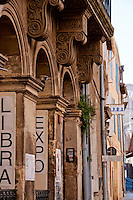 Close-up architectural details of a traditional building facade in the historic city of Arles, France.