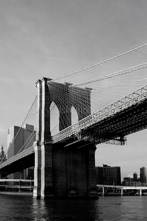 Brooklyn Bridge, New York, seen from a boat on the East River, with Manhattan in the background.
