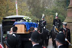 © Licensed to London News Pictures . 02/11/2015 . Liverpool , UK . The coffin is carried in to the Cathedral . The funeral of Police Constable Dave Phillips , at Liverpool Cathedral . Five people are charged in connection with his death , including Clayton Williams , 18 , from Wallasey , who is charged with murder . Photo credit: Joel Goodman/LNP